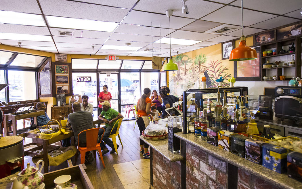 People enjoy drinks and food at Java Tree at Flamingo Road and Decatur Boulevard in Las Vegas o ...