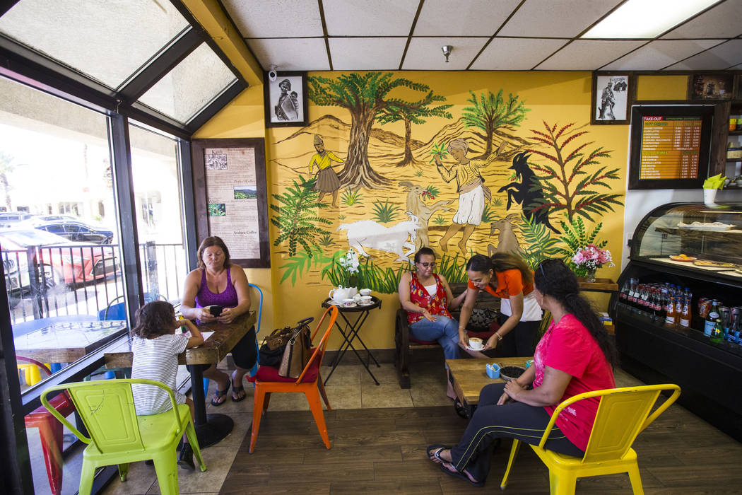 Gio Marongiu, store manager at Java Tree, second from right, serves coffee for Saba at Java Tre ...