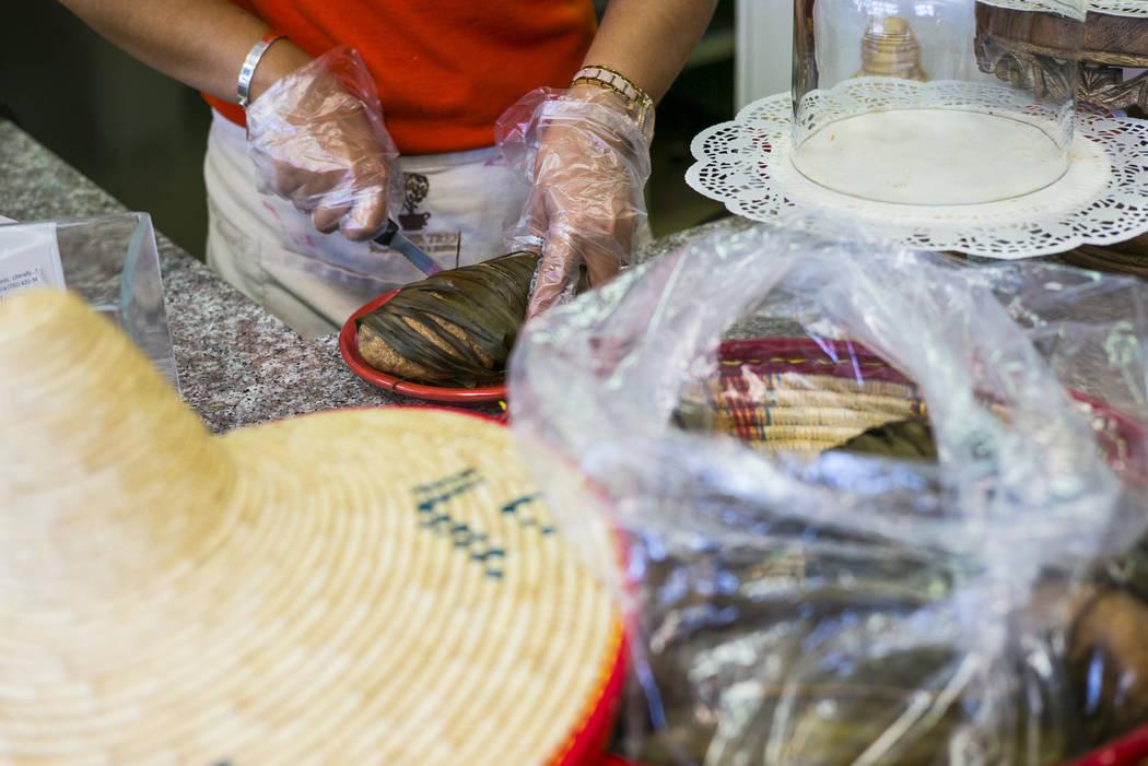 Gio Marongiu, store manager at Java Tree, prepares a dish of Ethiopian mulmul bread at Java Tr ...