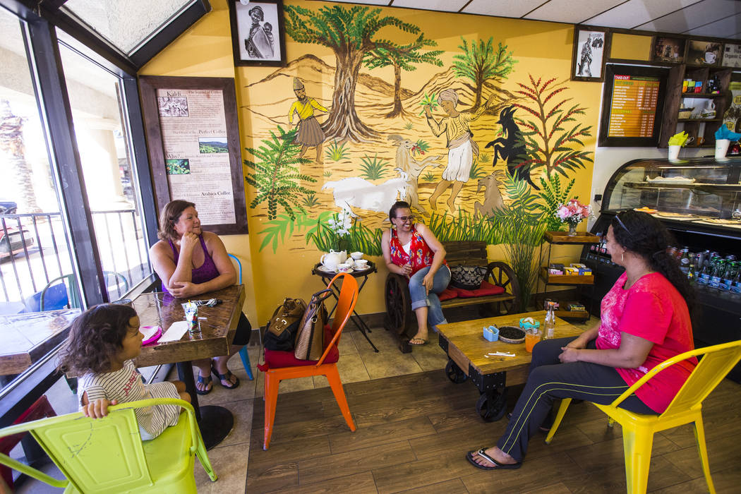 Brenda Colon, upper left, of Las Vegas, waits for tea and coffee to be served while sitting wit ...
