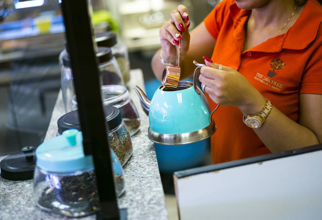 Gio Marongiu, store manager at Java Tree, prepares tea at the store at Flamingo Road and Decatu ...