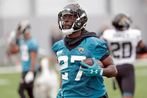 Jacksonville Jaguars running back Leonard Fournette runs with the ball during an NFL football p ...