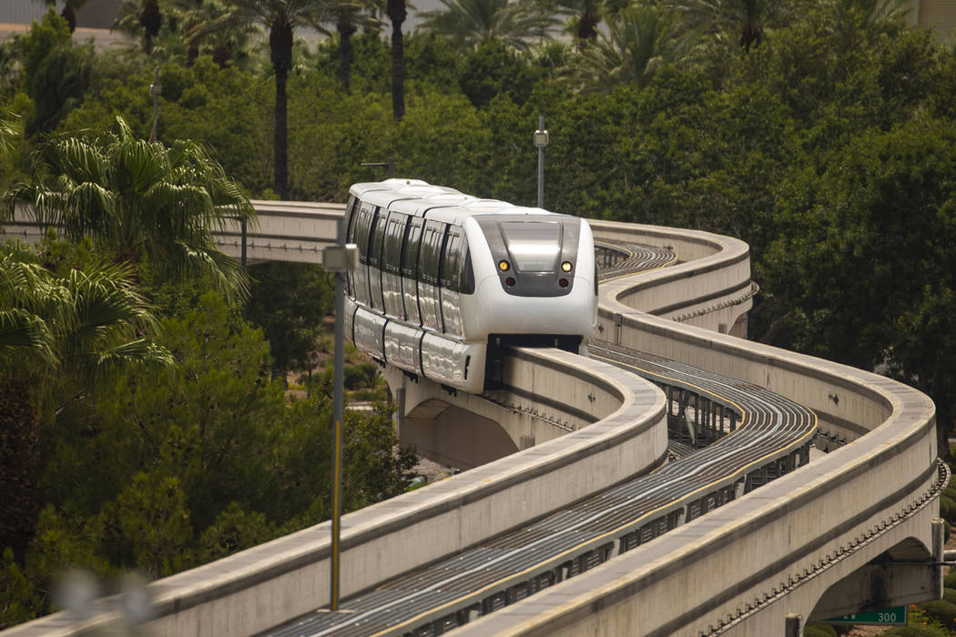 A train makes its way towards the SLS Station along the Las Vegas Monorail system on Sunday, Au ...