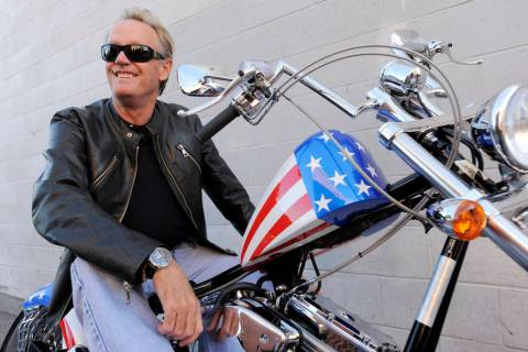 Peter Fonda poses atop a Harley-Davidson motorcycle in Glendale, Calif., in 2009. (AP Photo/Ch ...