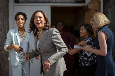 Democratic presidential candidate Sen. Kamala Harris, D-Calif., smiles with Deputy Political Di ...