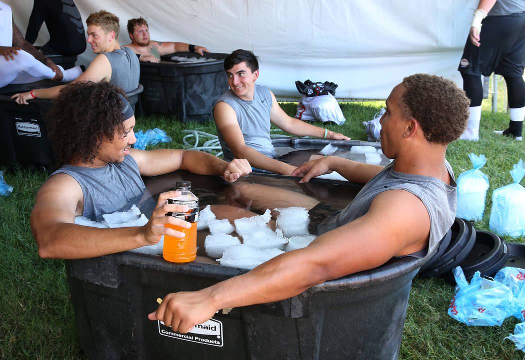 UNLV's defensive back Greg Francis, left, linebacker Tre Caine, right, and kicker Evan Silva, c ...