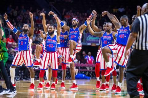"Harlem Globetrotters strike a ""Karate Kid"" pose versus the Washington Generals during ..."