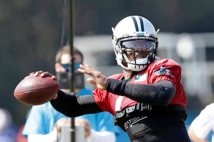 Carolina Panthers quarterback Cam Newton passes during an NFL football training camp with the B ...
