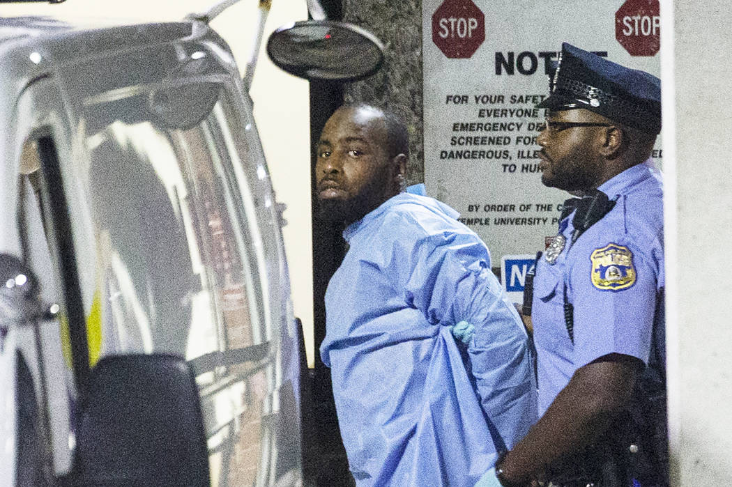 Police take shooting suspect, Maurice Hill, into custody after an hourslong standoff with polic ...