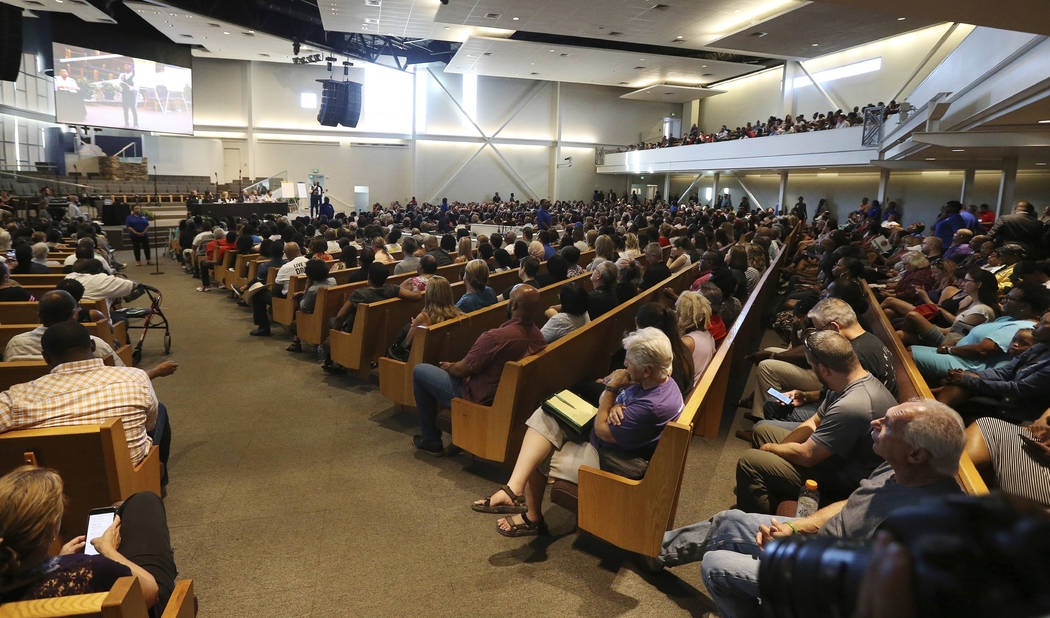 In this June 18, 2019 file photo people attend a community meeting in Phoenix. Still stinging f ...