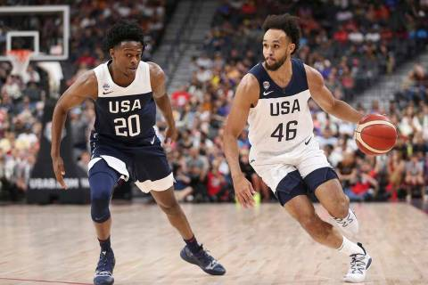 Team White guard Derrick White (46) dribbles the ball past Team Blue guard De'Aaron Fox (20) du ...