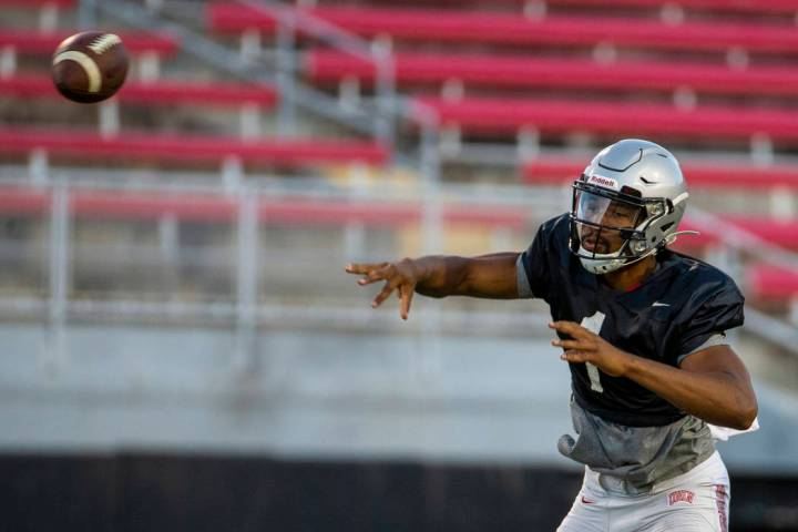 Quarterback Armani Rogers (1) passes to a receiver during the UNLV football team scrimmage at S ...