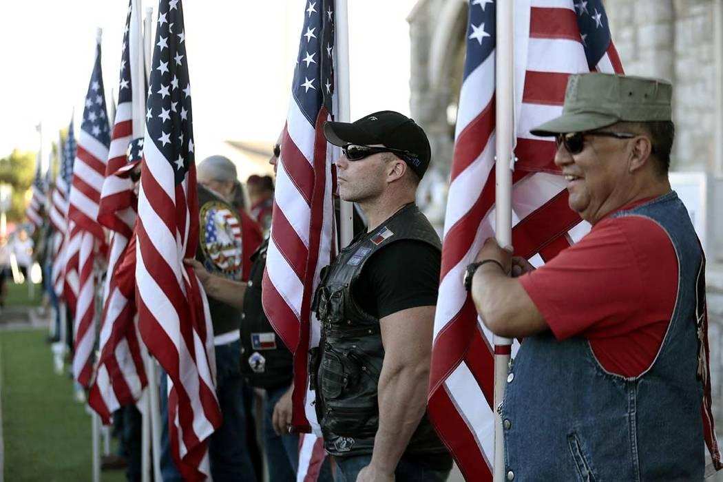 Veterans groups line the sidewalk outside Margie Reckard's funeral at La Paz Faith Memorial &am ...