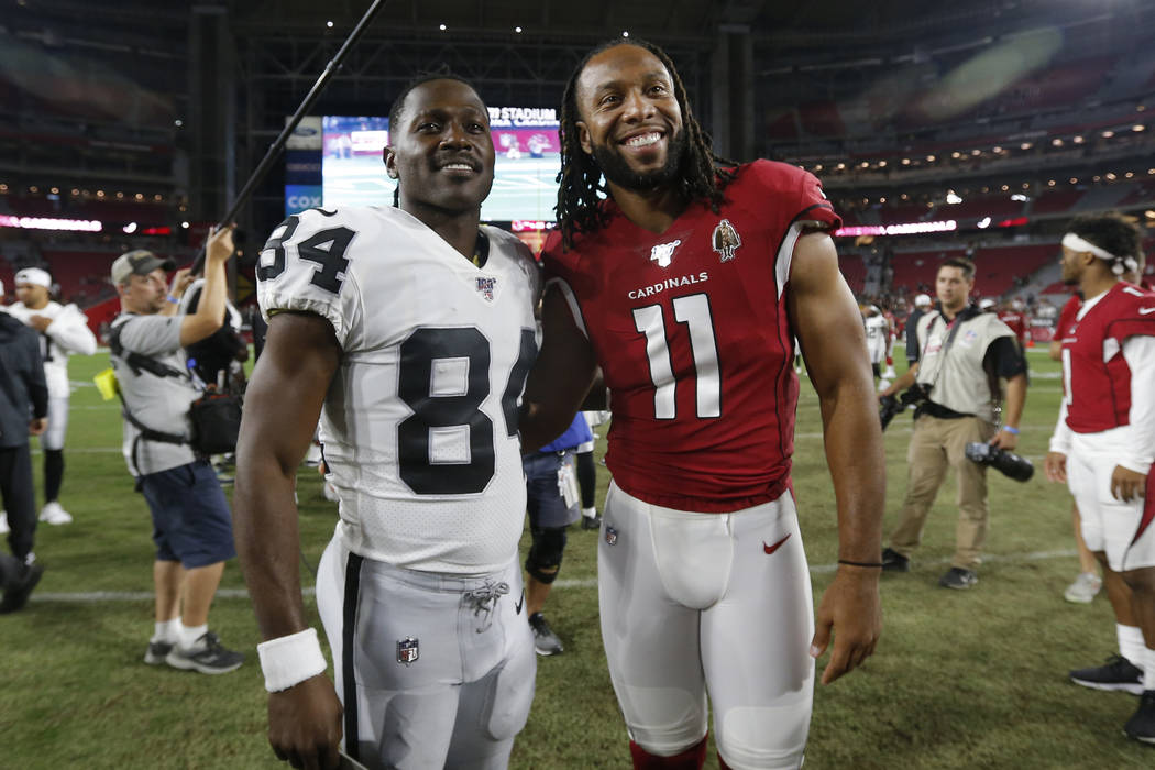 Arizona Cardinals wide receiver Larry Fitzgerald (11) and Oakland Raiders wide receiver Antonio ...