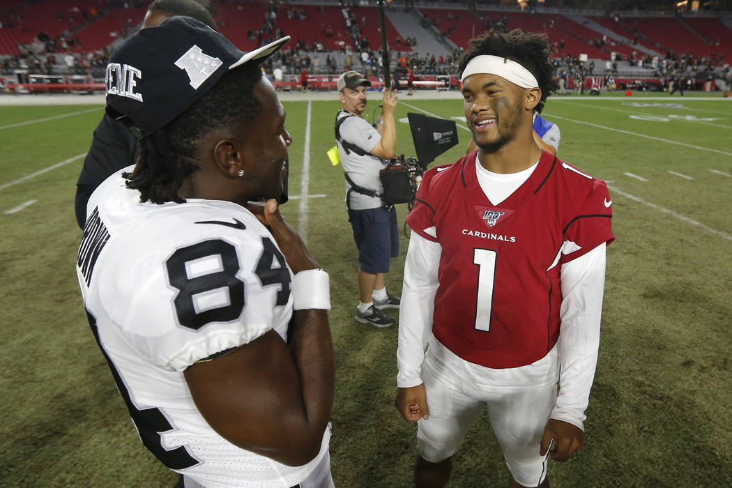 Oakland Raiders receiver Antonio Brown (84) and Arizona Cardinals quarterback Kyler Murray (1) ...