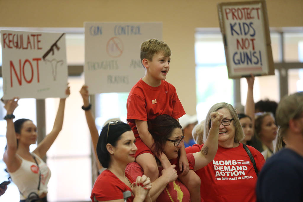Shawna Stafford, 8, center, of Las Vegas, carries her son Ty, 8, with her sister Melja, left, a ...