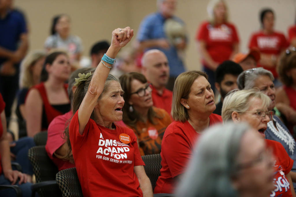 """Gloria Corder, left, raises her hand as she yells """"Enough"""", during an event by the Ne ..."""
