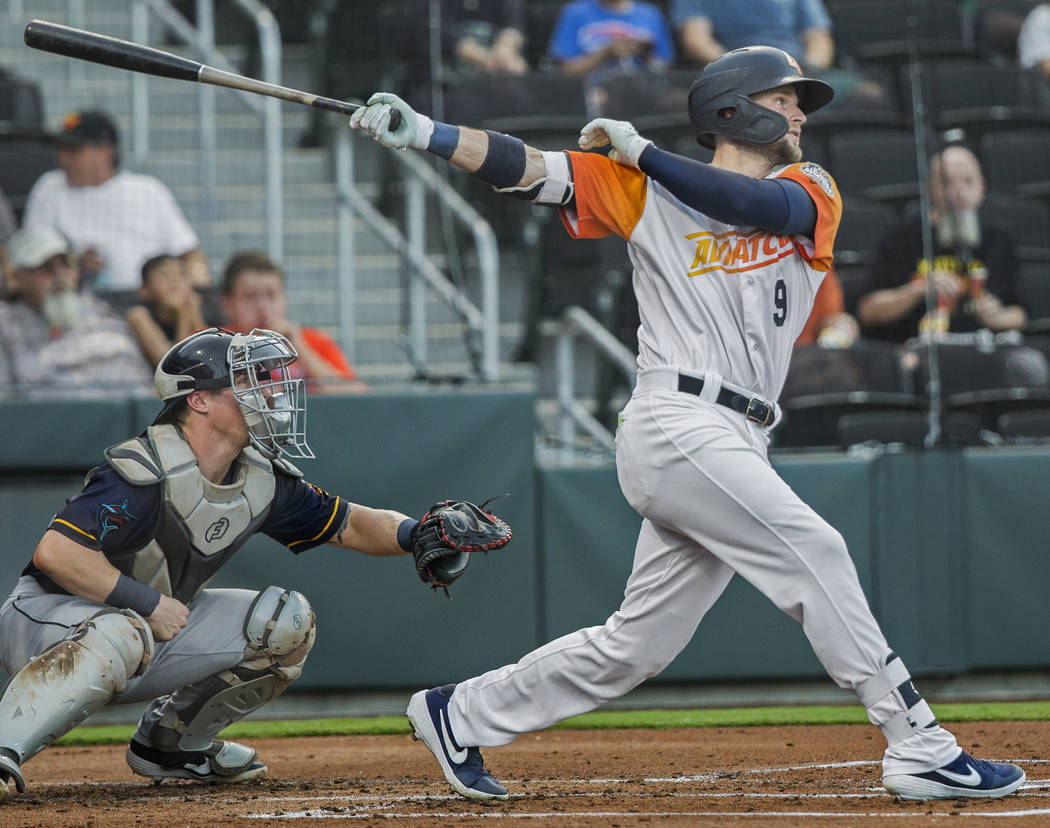 Las Vegas Aviators first baseman Seth Brown (9) hits a single in the bottom of the first inning ...