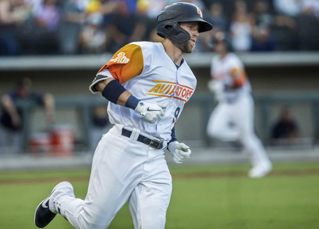 Las Vegas Aviators first baseman Seth Brown (9) rounds first base after singling in the bottom ...