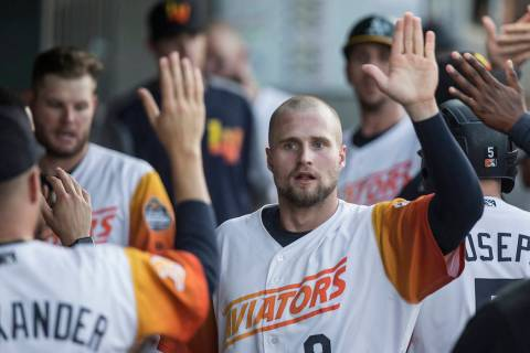 Las Vegas Aviators first baseman Seth Brown (9) high fives his teammates after scoring in the b ...