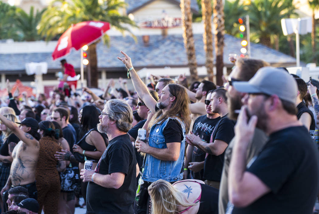 Metal fans cheer as Yob performs at the beach stage during the Psycho Las Vegas music festival ...
