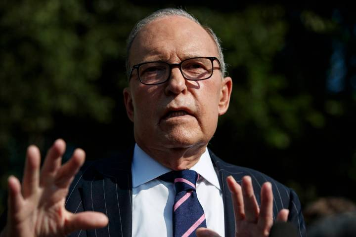 White House chief economic adviser Larry Kudlow talks with reporters outside the White House, T ...