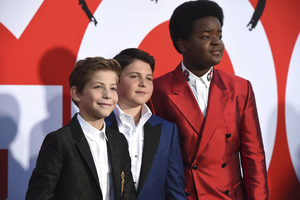 "Jacob Tremblay, from left, Brady Noon and Keith L. Williams arrive at the premiere of ""Goo ..."