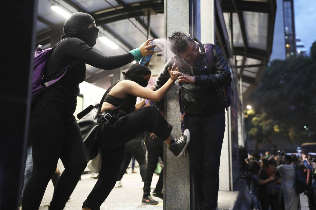 Two women assault a commuter, one spraying him in the face with paint another kicking him, at a ...