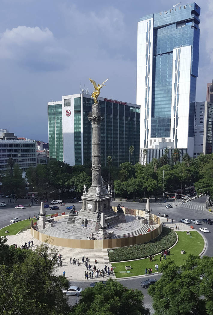 Mexican officials cordon off the iconic Angel of Independence monument after protesters defaced ...