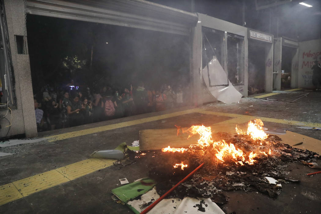 Debris burns at a bus station after protesters trashed the station during a women's march spark ...