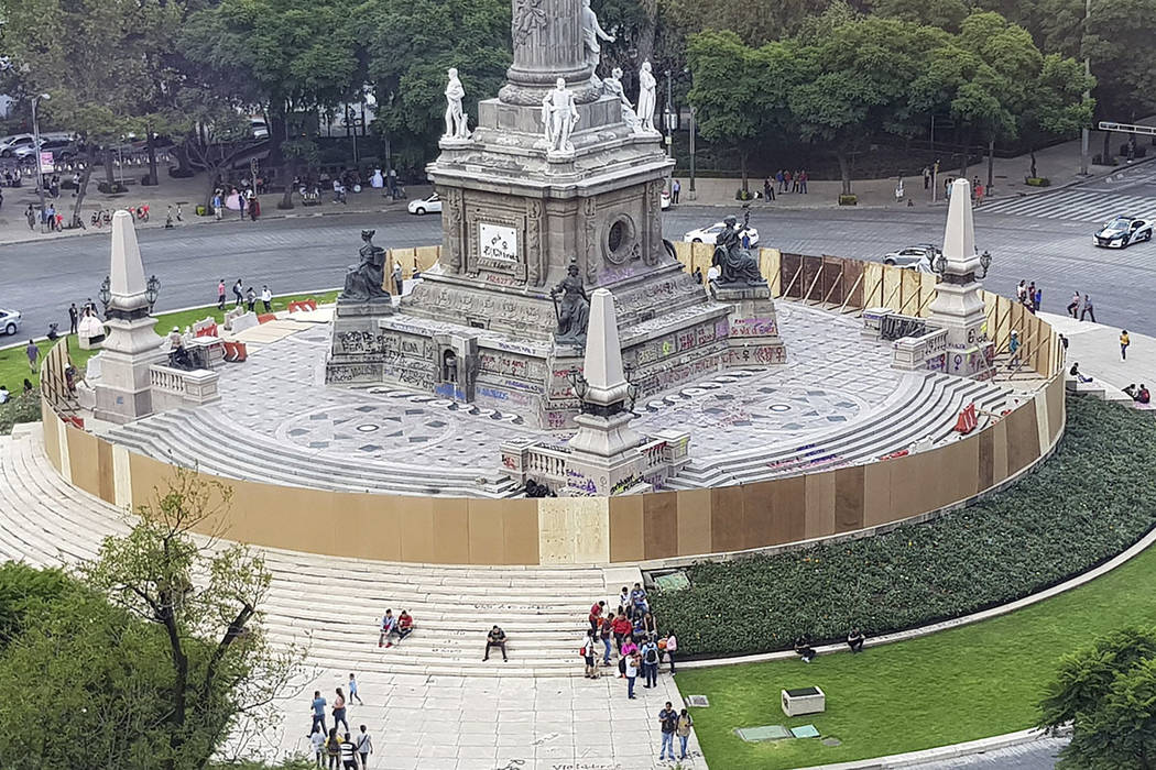Mexican officials cordon off the iconic Angel of Independence monument a day after protesters d ...
