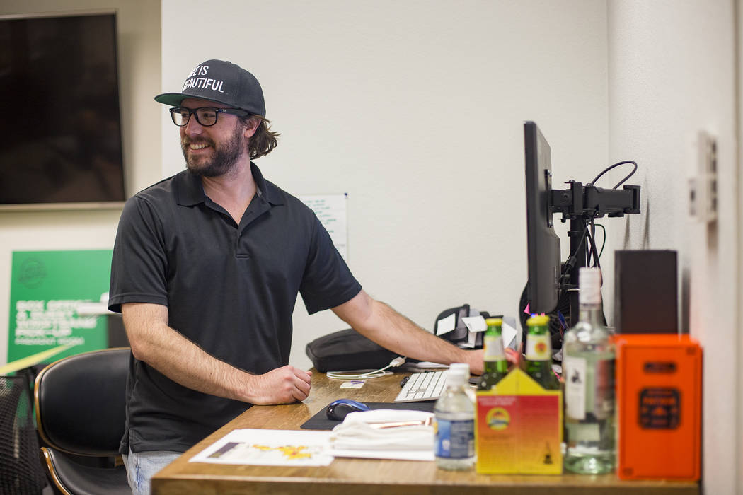 Lee Flint, the culinary director for Life Is Beautiful Festival, works at his desk at the Life ...
