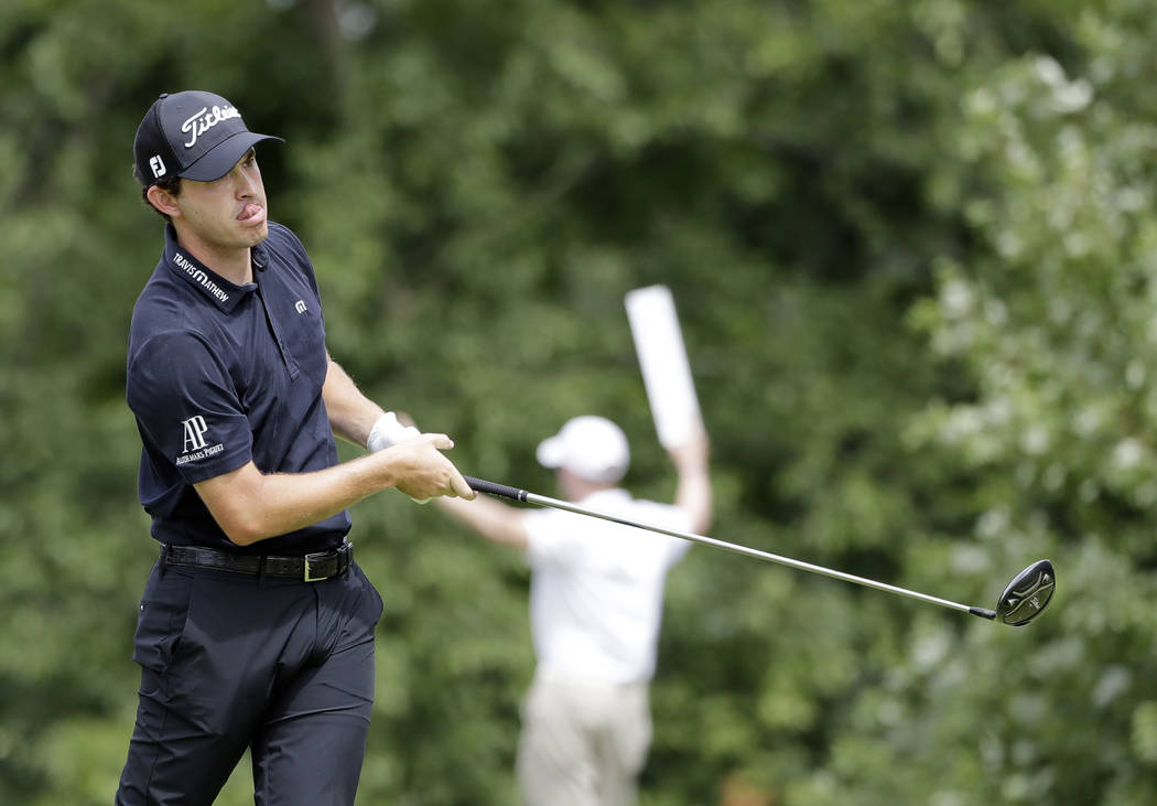 Patrick Cantlay watches his tee shot on the fifth hole during the final round of the BMW Champi ...