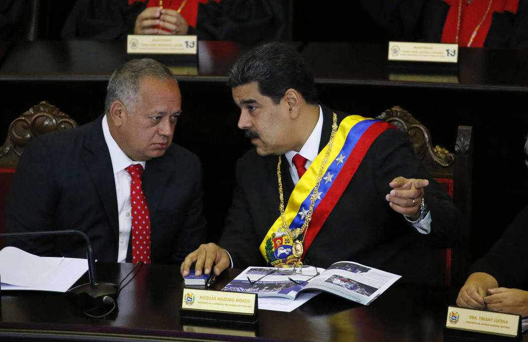 FILE - In this Jan. 24, 2019 file photo, Venezuelan President Nicolas Maduro, right, speaks wit ...