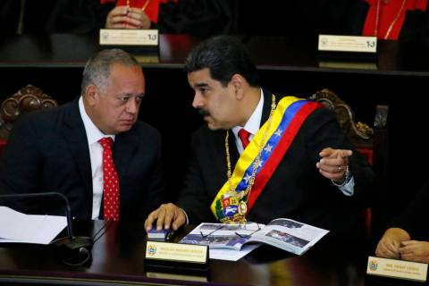 FILE - In this Jan. 24, 2019 file photo, Venezuelan President Nicolas Maduro, right, speaks wit ...