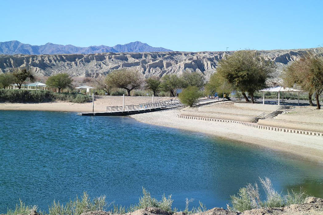 A wide lagoon with a sandy beach can be found at Big Bend of the Colorado State Recreation Area ...