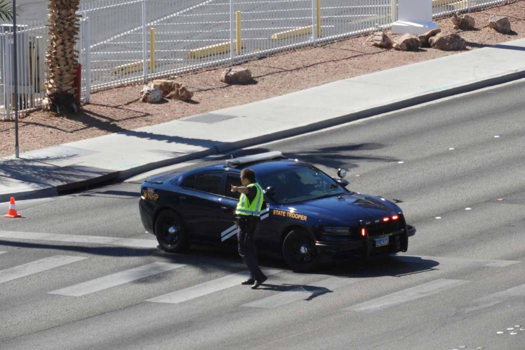 A Nevada Highway Patrol trooper directs traffic near the Aquarius Casino in Laughlin after an o ...
