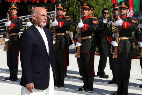 In this photo released by the Afghan Presidential Palace, Afghan President Ashraf Ghani inspect ...