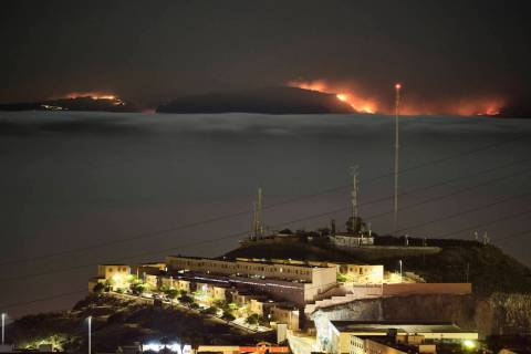 The fire on the mountains of the Canary Islands in this view taken from Santa Cruz de Tenerife ...