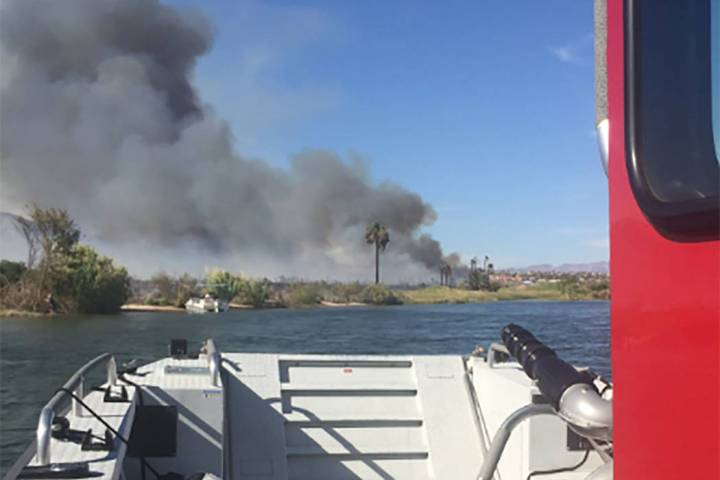 Crews battle a brush fire near the Big Bend of the Colorado State Recreation Area on Sunday, Au ...