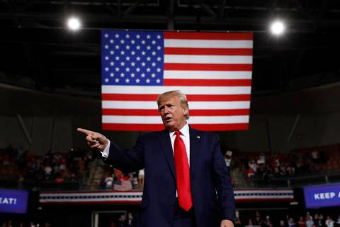 In this Aug. 15, 2019 file photo, President Donald Trump reacts at the end of his speech at a c ...