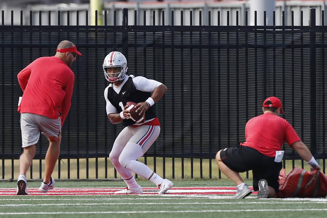 Ohio State quarterback Justin Fields runs a drill during NCAA college football practice in Colu ...