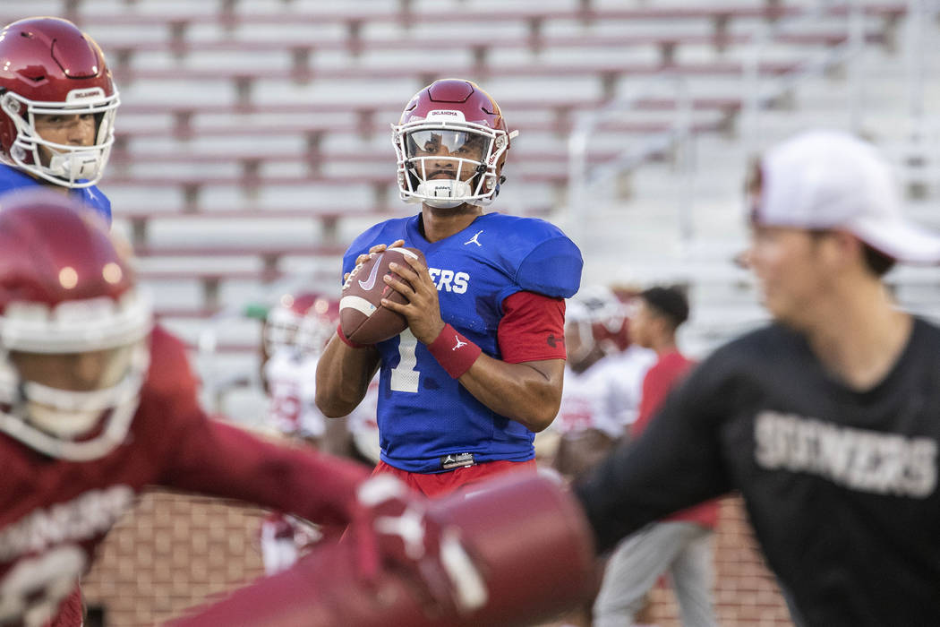 Oklahoma quarterback Jalen Hurts looks for an open receiver during NCAA college football practi ...