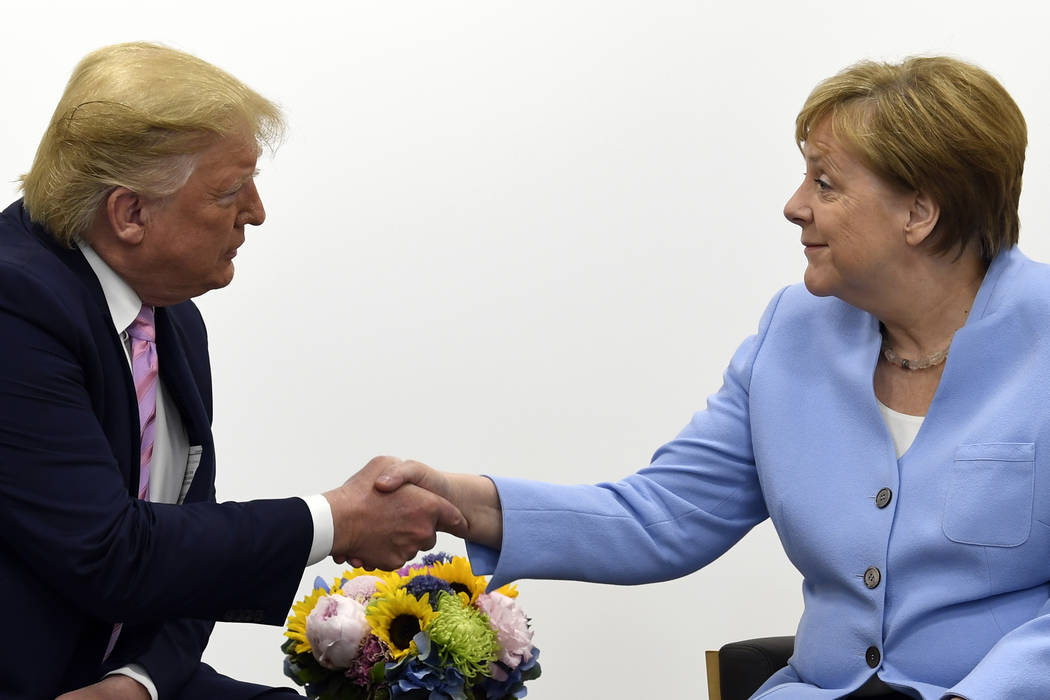 President Donald Trump meets with German Chancellor Angela Merkel on the sidelines of the G-20 ...