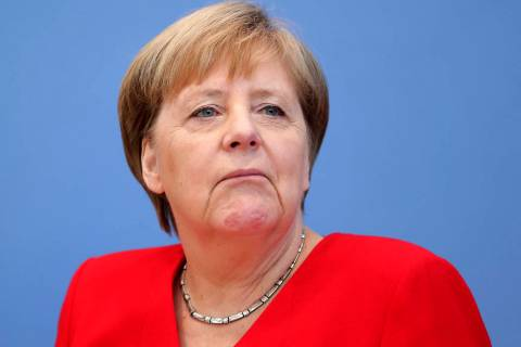 German Chancellor Angela Merkel attends her annual sommer press conference in Berlin, Germany, ...