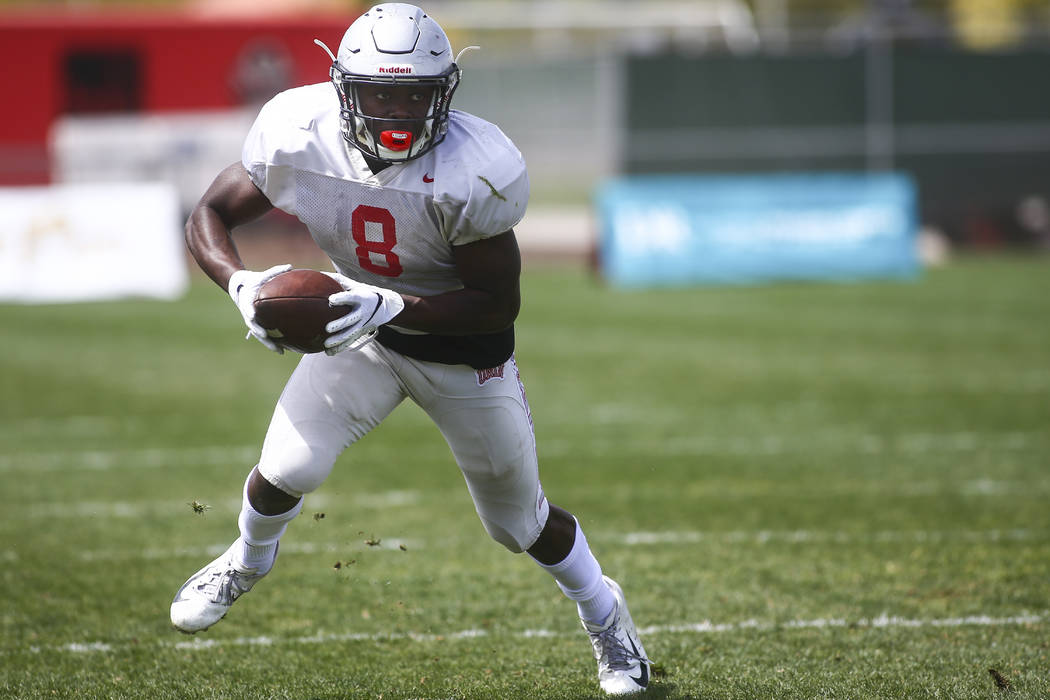 UNLV Rebels running back Charles Williams (8) runs the ball during the spring football game at ...