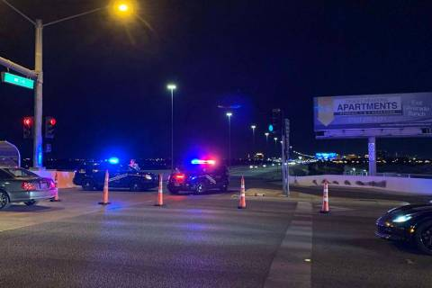Metropolitan Police Department officers block the Interstate 15 northbound ramp on Silverado Ra ...
