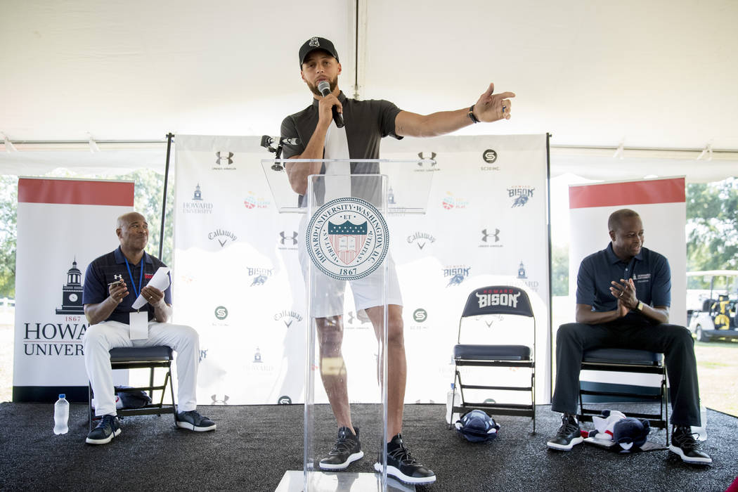 Golden State Warriors guard Stephen Curry speaks as Howard University Athletic Director Kery D ...