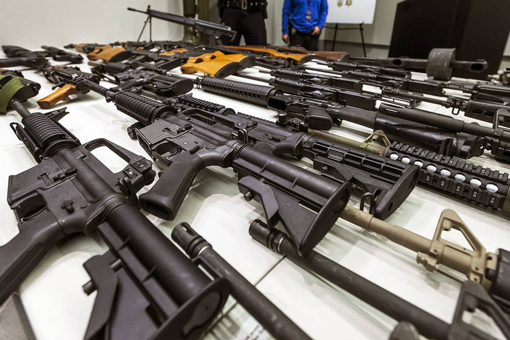 In this Dec. 27, 2012, file photo, a variety of military-style semi-automatic rifles obtained d ...