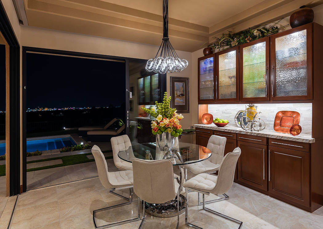 A breakfast nook looks out to the pool. (David Reisman Real Estate Millions)